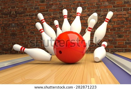 scattered skittle and bowling ball on wooden floor against the wall - stock photo