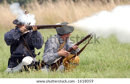 Scene from American Revolution battle re enactment at Fort George, Niagara On The Lake, Ontario, Canada. July 29/2006. - stock photo
