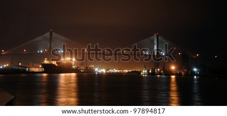 Scene from Savannah Georgia at night along the river - stock photo