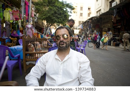 Scene from the Khan El Khalili bazaar in Cairo,  a major souk in the Islamic district of Cairo, Egypt. After shopping - stock photo