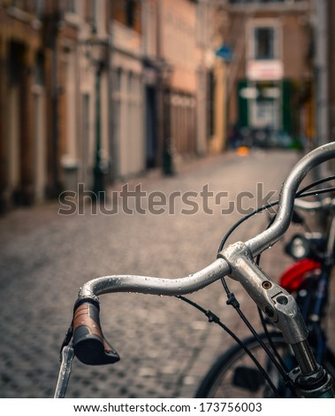Scene Of A Bicycle In The Rain On A Cobbled European Backstreet - stock photo