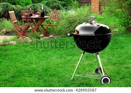 Scene Of Family Barbecue Grill Party Or Picnic On The Lawn In The Backyard At Summertime Weekend. - stock photo