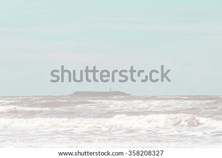 scene of island and light pole with strong wave in the windy day. -vintage. - stock photo