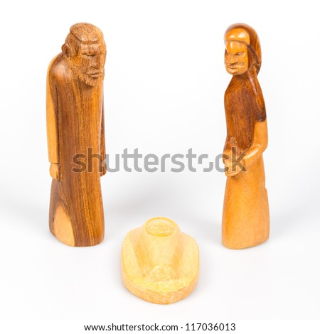 Scene of the Christmas crib, made of wood, isolated - stock photo