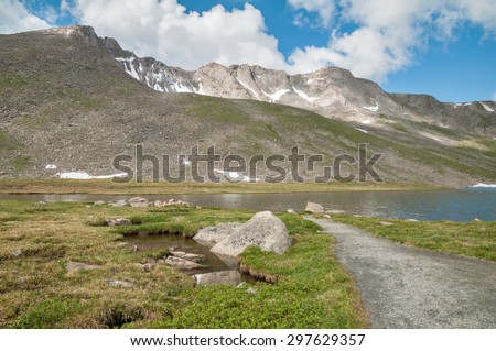 Scenery and path at Summit Lake in Mt. Evans Wilderness Area in Colorado. - stock photo