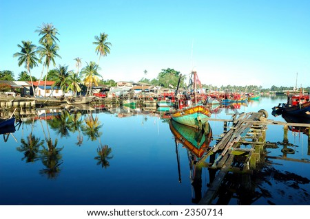 Scenery of a fishing village with beautiful reflection - stock photo