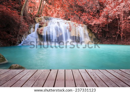 Scenery of Erawan waterfall, red leaf and blue water. - stock photo