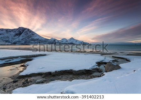 Scenery of fjord with high mountain in winter, Lyngsalpene, Norway - stock photo