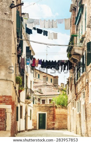 Scenery of hanging clothes in Venice, Italy. - stock photo