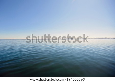 scenery of lake and horizon line on mountains - stock photo