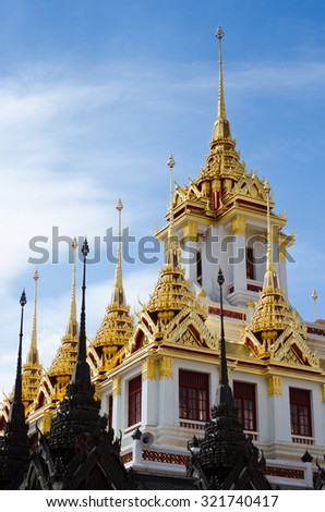 Scenery of Loha Prasat (or Metal Castle) On Background of Blue Sky, A Place Is A World Heritage Site at Wat Ratchanaddaram at Bangkok, Thailand. - stock photo