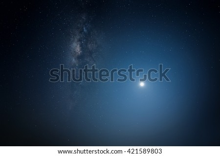 Scenery of milkyway and small moon side by side. ( Visible noise due to high ISO, soft focus, shallow DOF, slight motion blur due to long exposure shot) - stock photo