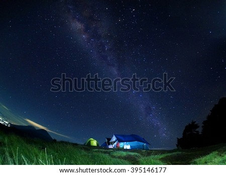Scenery of milkyway with view of Mount Sindoro at the back. Image contains visible noise due to high ISO, soft focus, shallow DOF, slight motion blur. - stock photo