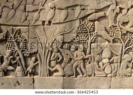 Scenes from daily life,  bas relief sculpture in Bayon, Angkor Thom,  Cambodia - stock photo