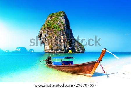 Scenic adventure background of amazing white sand beach on coast of tropical island in Thailand - stock photo