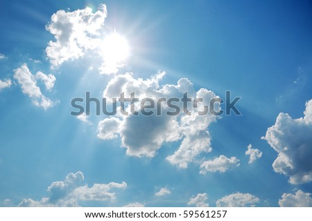 scenic blue sky with sun and clouds - stock photo