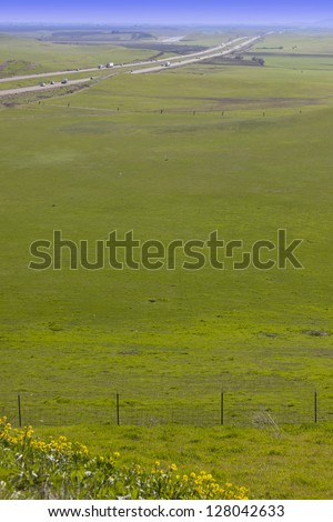Scenic California Interstate I-5 Along Green Pastures and Farmland. - stock photo