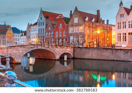 Scenic city view of Bruges canal with beautiful medieval colored houses, bridge and reflections, Belgium - stock photo