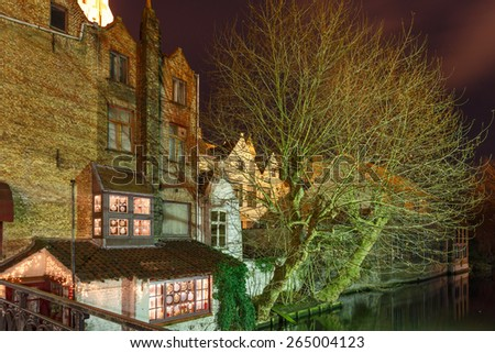 Scenic cityscape with the picturesque night medieval canal in Bruges, Belgium - stock photo