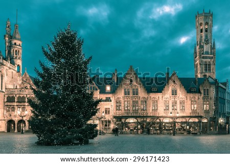 Scenic cityscape with the picturesque night medieval Christmas Burg Square in Bruges, Belgium. Toning in cool tones - stock photo