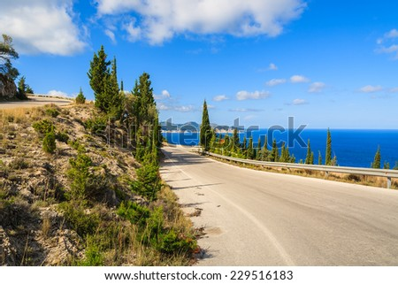 Scenic coastal road to Assos village in mountain landscape of Kefalonia island, Greece  - stock photo