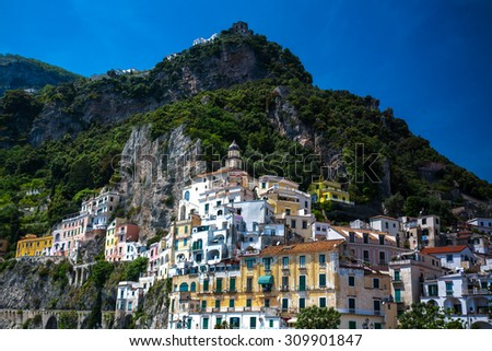 Scenic colorful old houses on hill. Amalfi in Campania, Italy. - stock photo