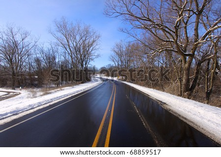 Scenic drive through a state park in Michigan in winter time - stock photo