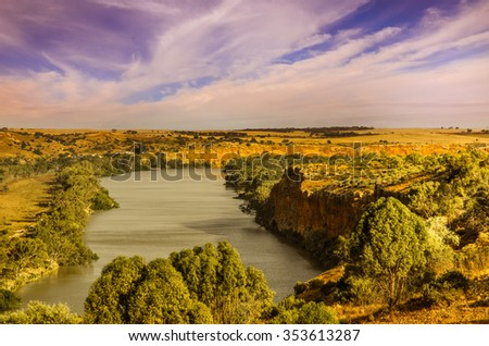Scenic high view of high cliff at Murray River late afternoon - stock photo