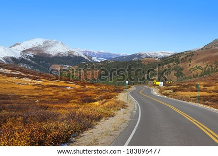 Scenic highway in Colorado rocky mountains - stock photo