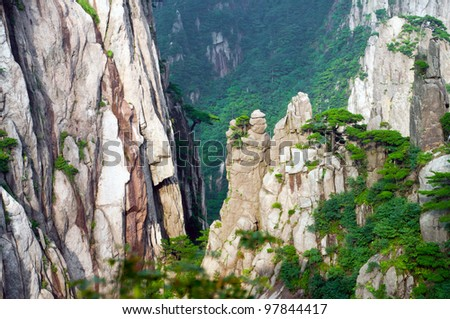 Scenic Huangshan mountain complex from atop a peak in China - stock photo
