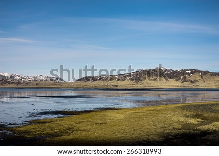Scenic lakes and snow covered mountains in Iceland during winter. - stock photo