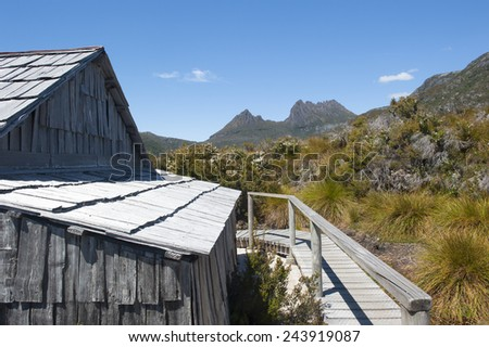 Scenic landscape of Cradle Mountain National Park in Tasmania, Australia, with historic shed, blue sky as copy space. - stock photo