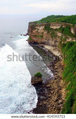 Scenic landscape of high cliff at Uluwatu Temple, Bali, Indonesia - stock photo