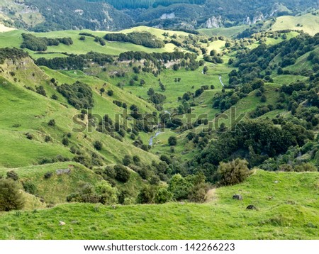 Scenic landscape of rural farmland pasture in hill country of Hawke's Bay district on North Island of New Zealand - stock photo