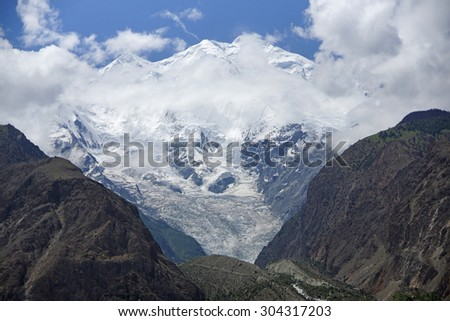 Scenic landscape - Rakaposhi Peak - Elevation 7,788 m - stock photo