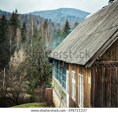 scenic landscape with cabin in mountains - stock photo