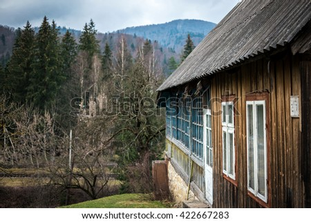 scenic landscape with wooden cabin in Carpathian mountains, Ukraine - stock photo