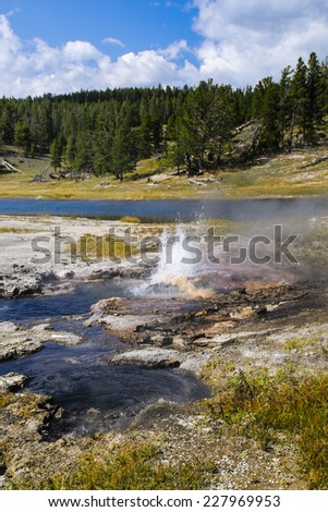 Scenic Landscapes of Geothermal activity of Yellowstone National Park USA - Firehole Lake - stock photo