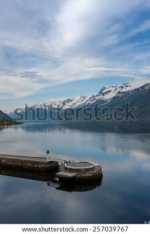 scenic landscapes of the northern Norwegian fjords in spring . The small jetty - stock photo