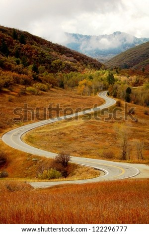 Scenic Mountain Pass, Curving Road - stock photo