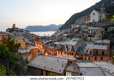 Scenic night view of village Vernazza and ocean coast in Cinque Terre, Italy - stock photo