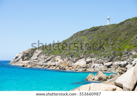 Scenic panorama of cliff coast of Torndirrup National Park, Albany, Western Australia, turquoise Southern Ocean, lighthouse, blue sky, copy space. - stock photo
