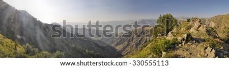 Scenic panorama of mountainous landscape of Tian Shan mountain range near Chimgan  in Uzbekistan - stock photo