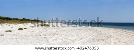 Scenic panoramic view of the soft white sandy shore at  Forrest Beach near Busselton, South Western Australia protected by Geographe Bay on a cloudy hazy afternoon in early autumn. - stock photo