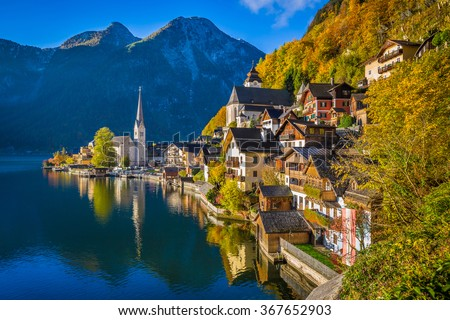 Scenic picture-postcard view of famous Hallstatt mountain village with Hallstatter See in the Austrian Alps in beautiful golden morning light in fall, region of Salzkammergut, Austria - stock photo
