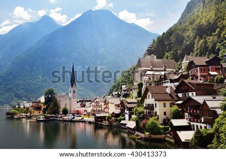 Scenic picture-postcard view of famous Hallstatt mountain with village over Hallstatter See in the Austrian Alps in beautiful golden light in summer, region of Salzkammergut, Austria - stock photo