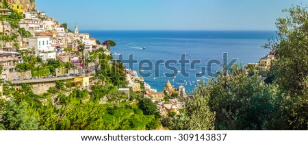 Scenic picture-postcard view of the town of Positano at famous Amalfi Coast with Gulf of Salerno in beautiful evening light, Campania, Italy - stock photo