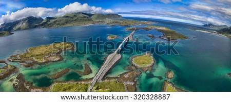 Scenic road bridges connecting islands on Lofoten in Norway - stock photo