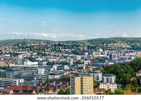 Scenic rooftop view of Stuttgart, Germany showing modern high-rise buildings amongst traditional historical architecture with view to the surrounding hills on a sunny day - stock photo