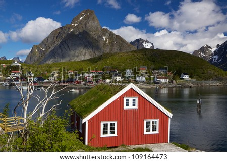 Scenic rorbu hut with sod roof in town of Reine on Lofoten islands in Norway - stock photo